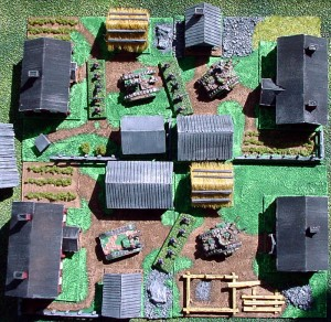 Aerial view of four yard-bases with Games Workshop Epic figures (1:300 scale)